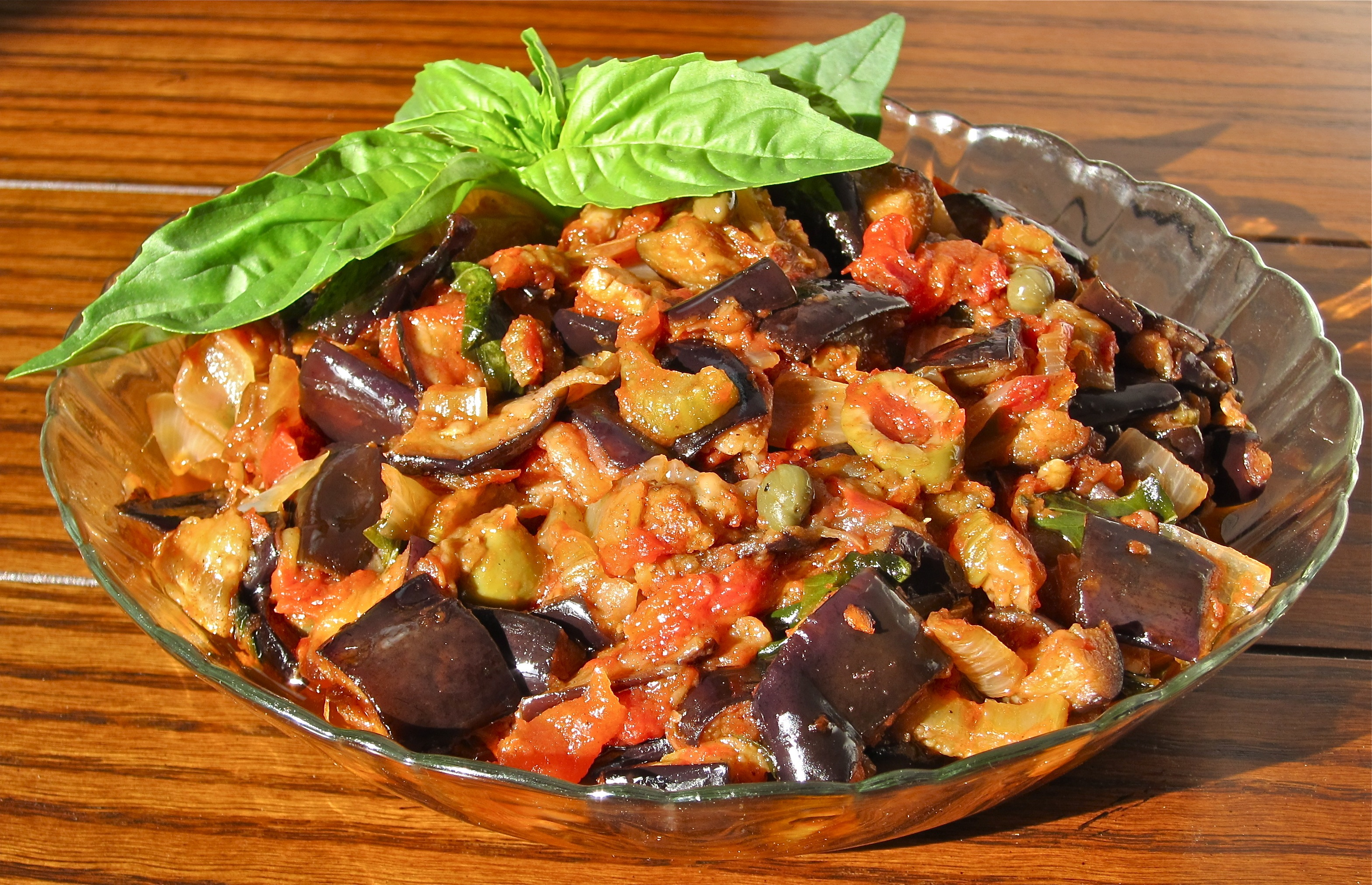 Helpfully, Garten shares her own recipe for the dish on her website, and it's incredibly simple: All you have to do is toss your vegetables—eggplant, bell peppers, onion, and garlic—in olive.