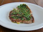 Grilled ribeye steak with an herb and EVOO sauce