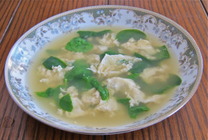 "This simple but elegant soup is at home in Rome or Naples. Little egg ""rags"" and spinach in chicken broth."