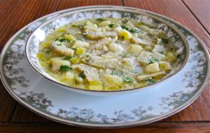 Tasty artichoke slices, leeks and potato in a thick thyme flavored broth
